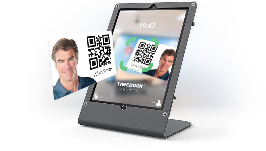 TimeDock employee time clock app on an iPad with desktop stand